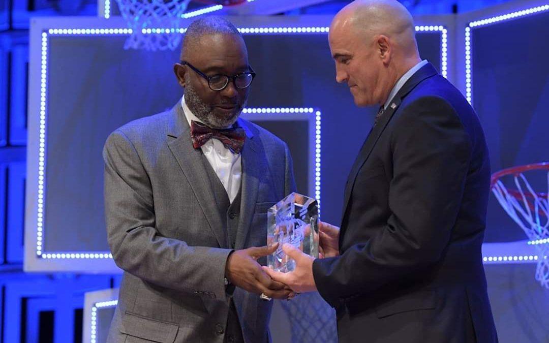Coach McKenzie accepting award